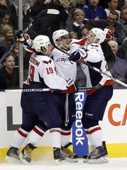Washington Capitals forward Ovechkin celebrates his third goal of the game with teammates Backstrom and Carlson during their NHL hockey game in Toronto