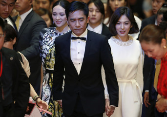 "Cast members Leung, Zhang and Song walk on the red carpet during an event promoting their movie ""The Grandmaster"", the opening film of the Chinese Film Festival, in Seoul"