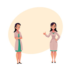 Two female, woman doctors in white medical coats, one with arms folded, another showing thumb up, cartoon vector illustration with space for text. Full length portrait of two female doctors