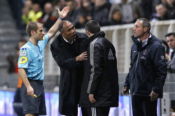 Paris St Germain's coach Kombouare is ejected from his team's bench by referee Philippe Kalt during his French Ligue 1 soccer match against Auxerre in Auxerre