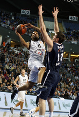 Law of Partizan Belgrade looks to score against Barac of Anadolu Efes during their Euroleague basketball game in Istanbul