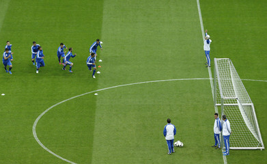 Players of the Greek soccer team warm up during their final practice session in Warsaw one day ahead of the opening match of the Euro 2012 against Poland in Warsaw