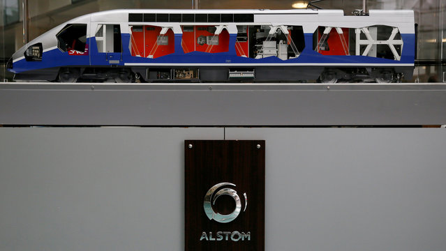 A scale model high speed train and the logo of the Alstom are seen seen before the the news conference to present the company's full year to end-March 2015/16 annual results in Saint-Ouen, near Paris