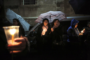 Coptic Christian women hold candles during a symbolic funeral for the 21 Egyptian Christians who were beheaded by Islamic State earlier this week, in Jerusalem's Old City