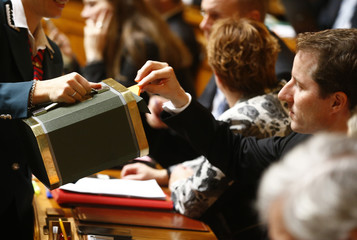 SVP's ministerial candidate Aeschi casts his vote during the ministerial elections in the Swiss Parliament in Bern