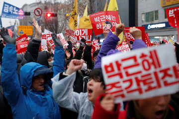 People chant slogans during a protest calling for Park Geun-hye to step down in central Seoul
