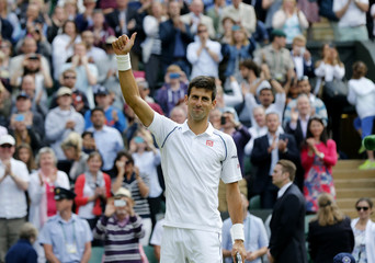Novak Djokovic of Serbia celebrates after winning his match against Marin Cilic of Croatia at the Wimbledon Tennis Championships in London