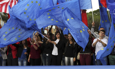 Supporters of Democratic Party of Albania wave flags during an anti-government protest in front of the Prime Minister's office in Tirana