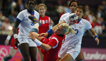 Norway's Heidi Loke attempts to score against France during their women's handball Preliminaries Group B match at the Copper Box venue of the London 2012 Olympic Games