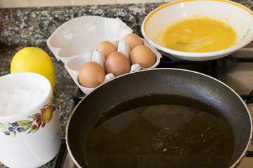 preparing a frittata with beaten eggs and pan