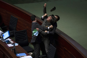 Pro-democracy lawmaker Leung Kwok-hung demands a universal retirement protection scheme during the annual budget report at the Legislative Council in Hong Kong