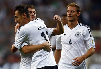 Germany's Klose, Kroos and Hoewedes celebrate during their 2014 World Cup qualifying soccer match against Austria in Munich