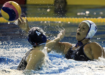 Villa of the U.S is blocked by Csikos of Canada during their women's water polo gold medal match at the Pan American Games in Guadalajara