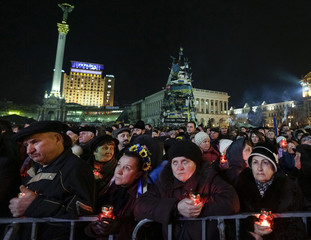 People attend a rally in Independence Square in Kiev