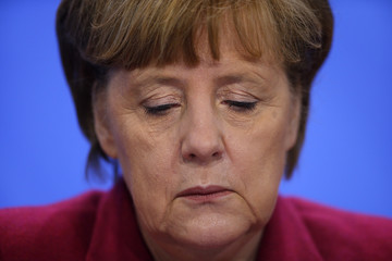German Chancellor Merkel pauses during a news conference with Swiss President Burkhalter in Berlin