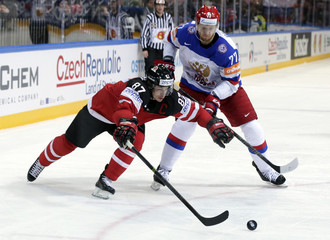 Russia's Belov challenges Canada's Crosby during their Ice Hockey World Championship final game at the O2 arena in Prague