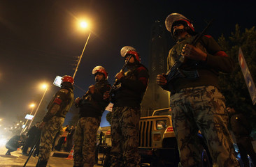 Military police guard the streets during the Coptic Christmas eve mass at the main cathedral in Cairo