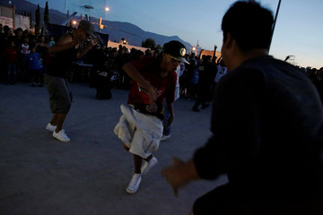 Police officers and residents dance together as part of an unconventional approach to connect the police with the community in rough neighbourhoods in Saltillo