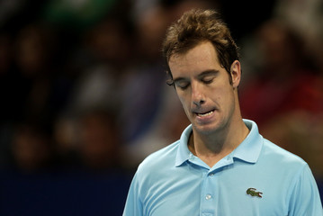 Gasquet of France reacts during his match against Argentina's del Potro at the Swiss Indoors ATP tennis tournament in Basel