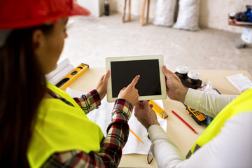 Engineers with tablet at construction site