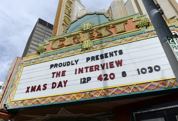 "The marquee of Crest Theater advertises the showing of the movie ""The Interview"" beginning Christmas Day in Los Angeles"