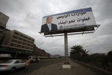 Poster of Yemen's President Hadi is seen on a billboard in the southern port city of Aden