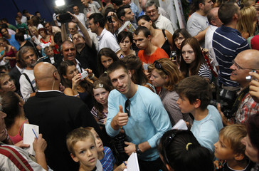 Pommel horse gold medallist Berki gestures to the supporters during a welcoming ceremony in Budapest
