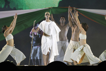 Dancers perform a tribute to Mahatma Gandhi after the T20 cricket match between South Africa and India at Moses Mabhida Stadium in Durban
