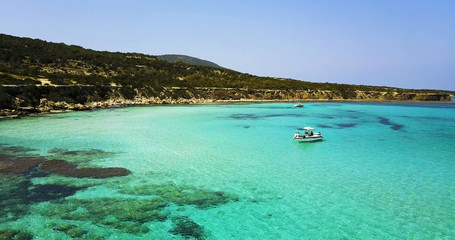 Landscape of a transparent clear blue Mediterranean Sea. The island of Cyprus. Resort. blue lagoon Yacht
