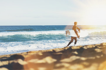 Surfer man holding surfboard on background sea scape, sand beach coastline. Panorama horizon perspective view ocean, sunlight. Travel summer sport concept, backdrop sunny waves seascape, mock up