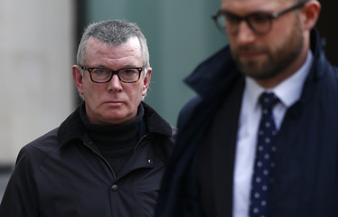 Banker, Colin Bermingham leaves Westminster Magistrates court in London