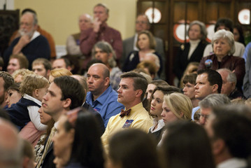 Supporters listen as republican presidential candidate and former Pennsylvania Senator Santorum speaks during a campaign stop at the Historic Springdale House & Gardens West Columbia
