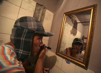 """Josue Paco Cruz puts on makeup while dressing up as Mexican TV comedian """"El Chavo del Ocho"""" at home in La Paz"""