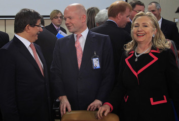 Turkish Foreign Minister Davutoglu talks with British Foreign Secretary Hague and U.S. Secretary of State Clinton during NATO foreign ministers meeting in Brussels