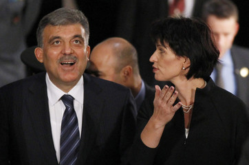 Turkey's President Abdullah Gul is welcomed by his counterpart Switzerland's President Doris Leuthard at Switzerland's Federal Palace in Bern