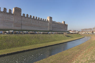 Panoramic view of defensive walls with towers and ditch at medieval city Cittadella, Veneto
