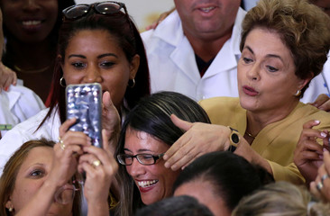 Brazilian President Rousseff poses for a picture with doctors after a ceremony marking the extension of the Programa Mais Medicos, in Brasilia