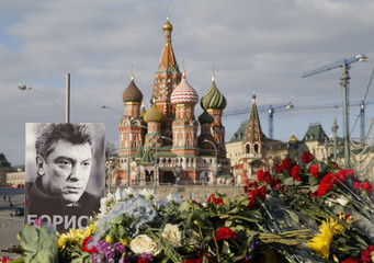 A portrait of Kremlin critic Nemtsov and flowers are pictured at the site where he was killed on February 27, with St. Basil's Cathedral seen in the background, at the Great Moskvoretsky Bridge in central Moscow