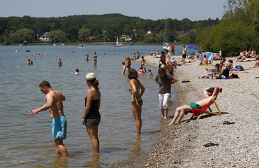 People cool down with a bath in lake Ammersee in Herrsching