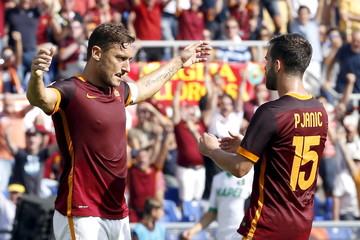 AS Roma's Totti celebrates after scoring against Sassuolo during their Serie A soccer match in Rome