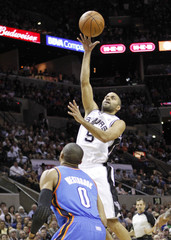 Spurs point guard Parker shoots over Oklahoma City Thunder guard Westbrook in San Antonio