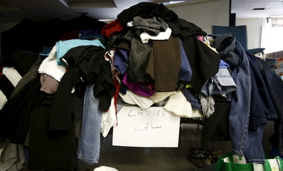 Clothing donations for Syrian refugees who are expected to arrive in Canada within the next month are seen on a table after being sorted, at the Middle Eastern Friendship Centre in Surrey