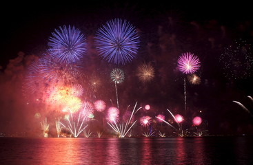 Fireworks explode during Qatar's National Day celebrations at Doha Corniche