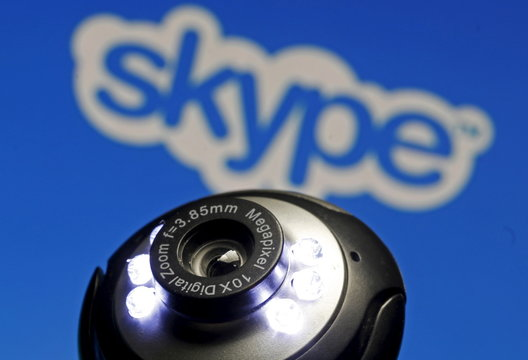 A web camera is seen in front of a Skype logo in this photo illustration taken in Zenica