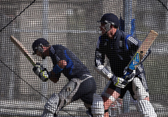 England cricket team players Pietersen and Root bat in the nets during a training session at the University Oval in Dunedin