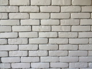Brick block wall background in living room at home, white wall in house , restaurant or cafe, white big brick block wall wallpaper in cafe on horizontal side, architect interior design