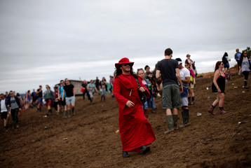 Reveller takes part in the Vloody Cloody Heroes Parade during the Glastonbury Festival at Worthy Farm in Somerset