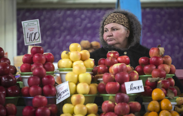 A vendor sells fruit at the Green Bazaar in Almaty