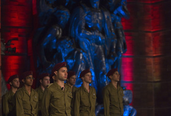 Israeli soldiers stand in formation during the opening ceremony of the annual Holocaust Memorial Day in Jerusalem
