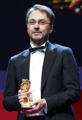 "Director Netzer holds the Golden Bear award for Best Film for his movie ""Pozitia Copilului"" (Child's Pose) during the awards ceremony at the 63rd Berlinale International Film Festival in Berlin"
